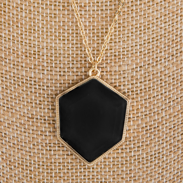 """Long metal necklace with acetate pendant. Approximate 26"""" in length."""