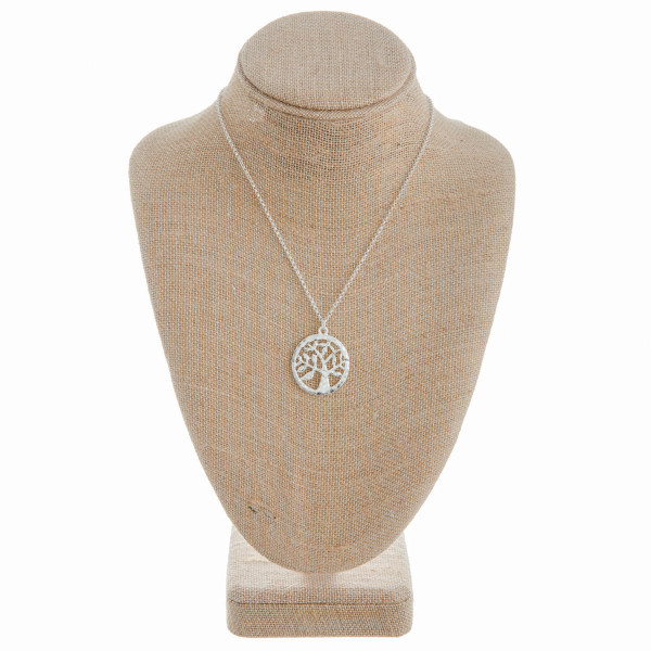 """Long metal necklace with tree of life  pendant. Approximate 18"""" in length."""