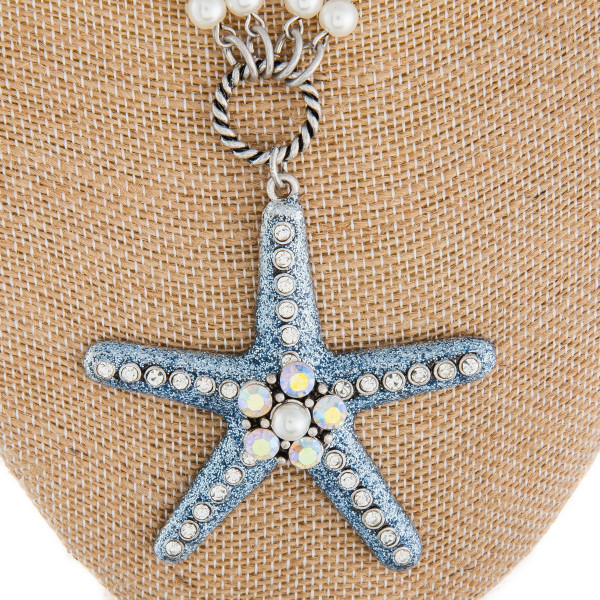 """Long metal and pearl necklace with starfish pendant. Approximate 36"""" in length with 2.5"""" pendant."""