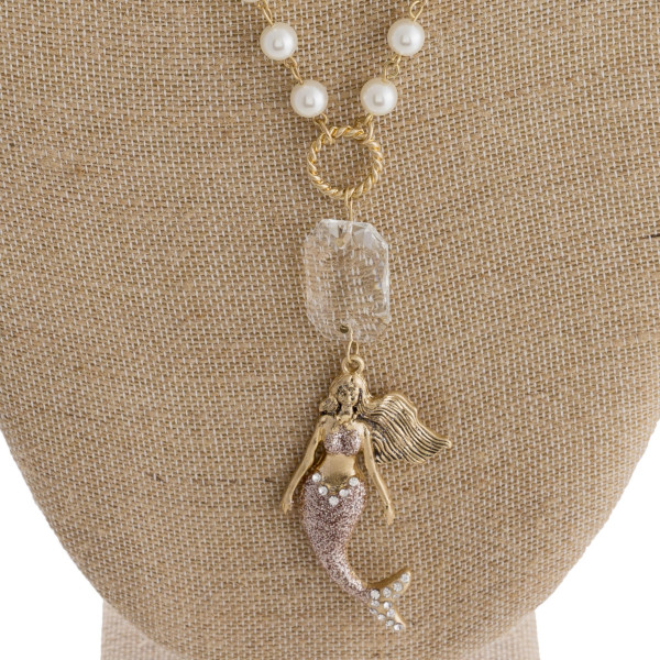 """Long beaded pearl necklace with mermaid pendant with rhinestones. Approximate 30"""" in length."""
