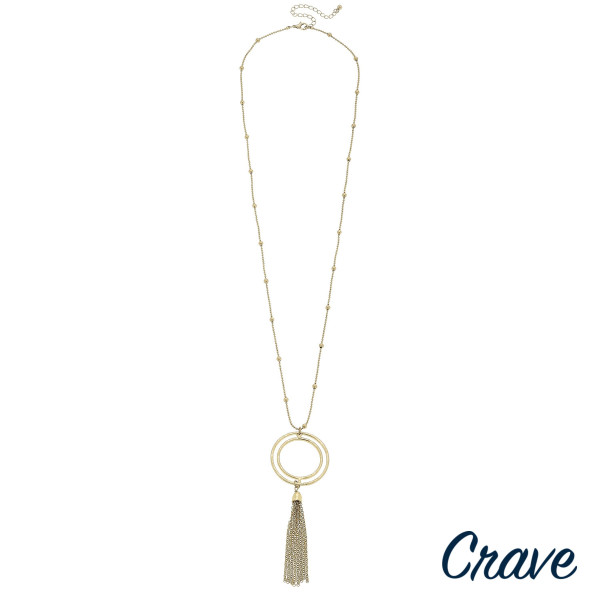 """Long crave metal necklace with hoop pendants and tassel. Approximate 34"""" in length."""