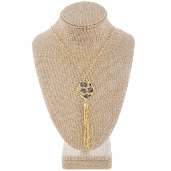 """Long metal necklace with moroccan shape pendant with tassel. Approximate 32"""" in length."""