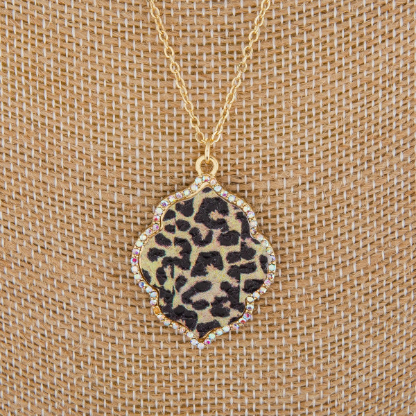 """Long metal necklace with rhinestone and moroccan pendant. Approximate 18"""" in length."""
