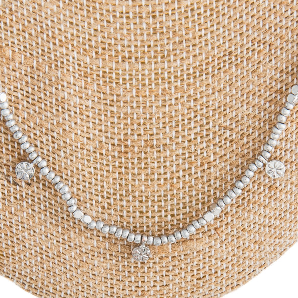 """Long silver beaded necklace with silver accents. Approximately 30"""" in length."""