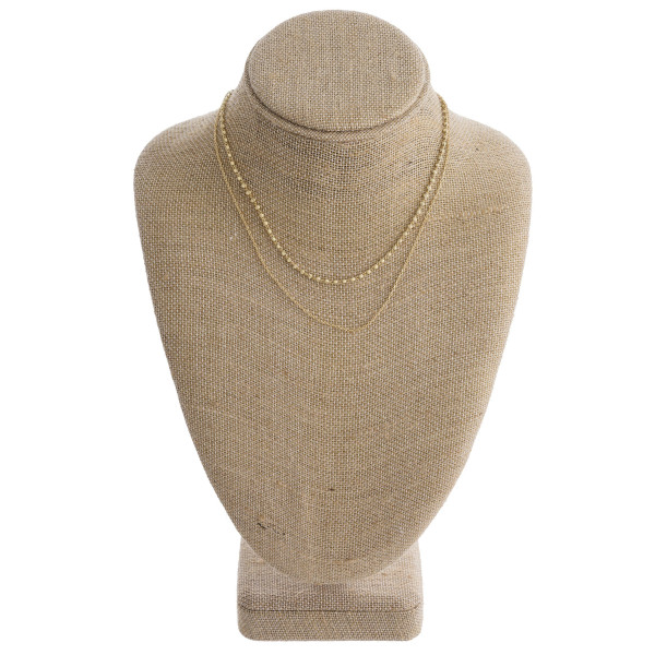 """Long multi layered necklace with bead details. Approximate 14"""" in length."""
