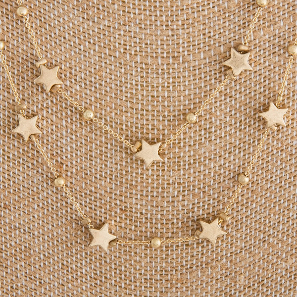 """Long metal layered star necklace. Approximate 18"""" in length."""