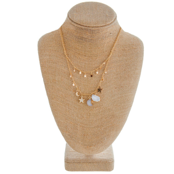 "Two-layered cable chain necklace featuring a pearl, druzy moon, and gold star accents. Approximately 18"" in length."