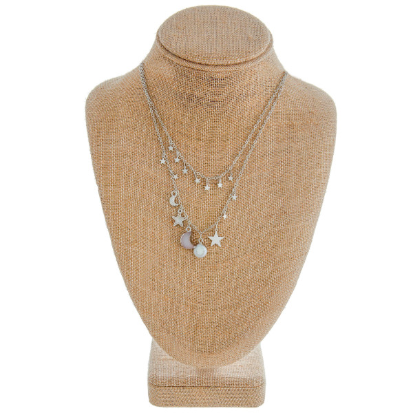 "Two-layered cable chain necklace featuring a pearl, druzy moon, and silver star accents. Approximately 18"" in length."