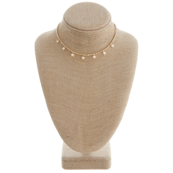 """Gold beaded necklace featuring gold star accents. Approximately 16"""" in length."""