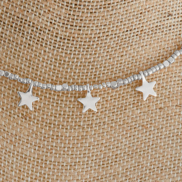 "Silver beaded necklace featuring silver star accents. Approximately 16"" in length."