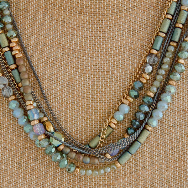 "Cable chain necklace featuring a multi strand beaded feature with iridescent bead details. Approximately 18"" in length."