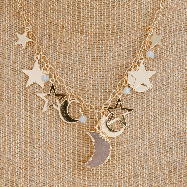 "Gold cable chain necklace featuring a druzy moon pendant with star and moon accents. Pendant approximately .75"". Approximately 18"" in length overall."