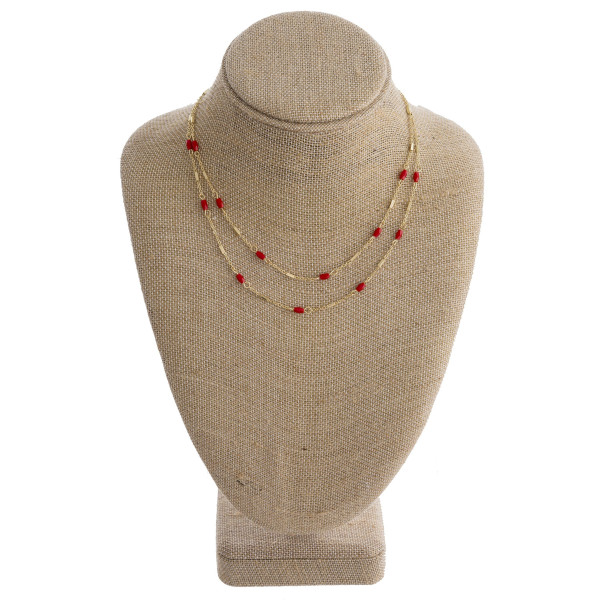 """Short  multi layered necklace with bead details. Approximate 14"""" in length."""