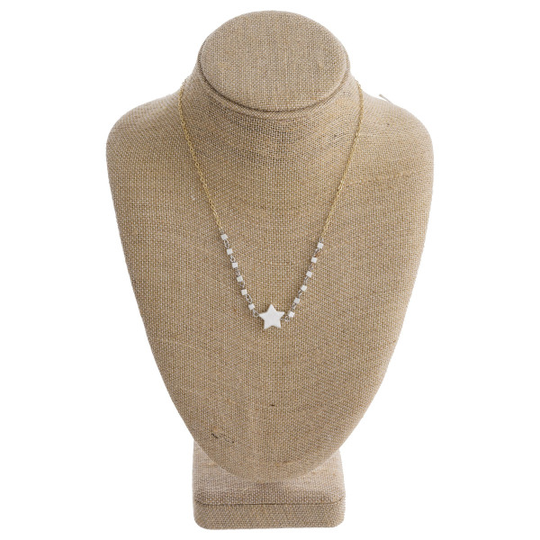 """Short metal necklace with star pendant. Approximate 14"""" in length."""
