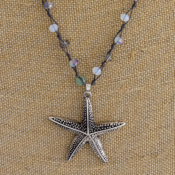 "Long fabric necklace with beads and starfish pendant. Approximate 22"" in length."