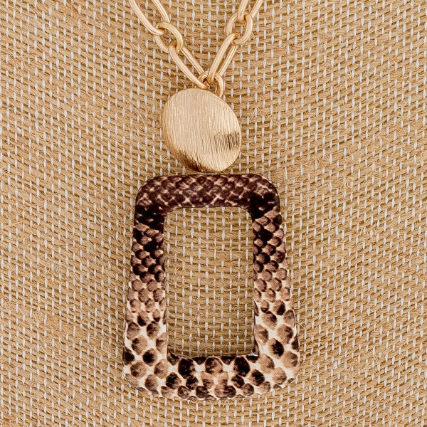 """Cable chain necklace featuring a faux leather snakeskin pendant and a gold disc accent. Pendant approximately 2"""". Approximately 18"""" in length overall."""
