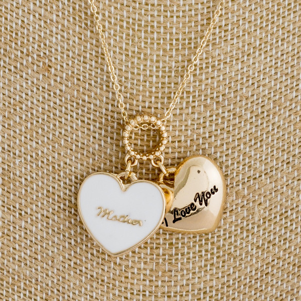"""Long metal necklace with heart pendants and """"I love mom"""" message. Approximate 18"""" in length."""