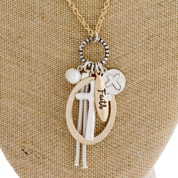 "Long gold chain necklace featuring a ""cross"" pendant with a pearl and tassel accent. Approximately 36"" in length."