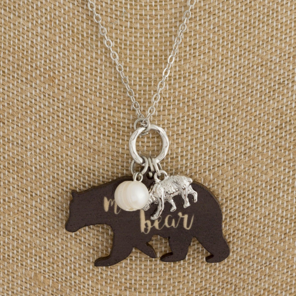 "Long metal necklace with mama bear pendant. Approximate 18"" in length."
