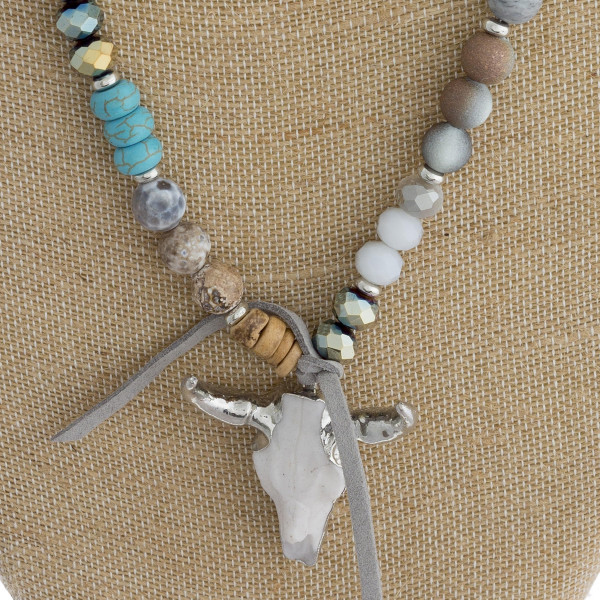 """Long beaded necklace with natural stone steer head pendant. Approximate 32"""" in length."""