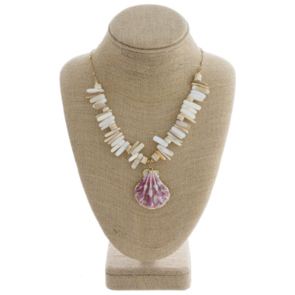 """Long metal necklace with natural stone detail and sea shell pendant. Approximate 24"""" in length."""