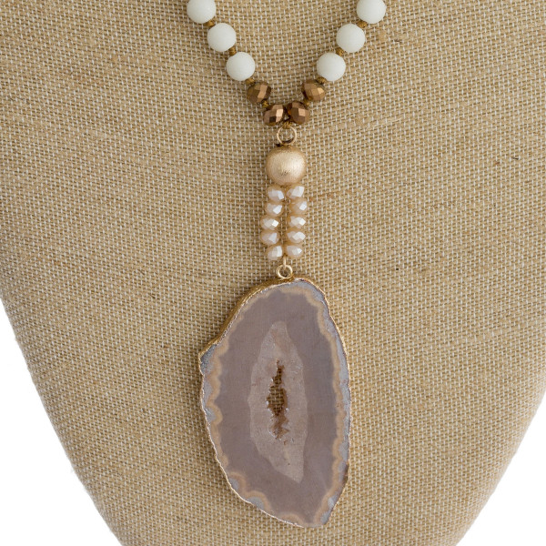 "Long beaded Y necklace with natural stone pendant. Approximate 42"" in length."