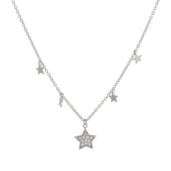 "Long metal necklace with rhinestone star pendants. Approximate 17.5"" in length."