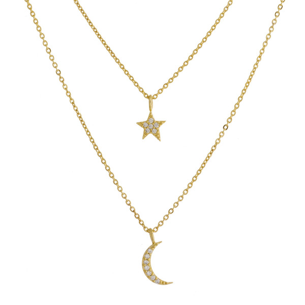 "Dainty layered metal necklace with star and moon rhinestone pendants. Approximate 17.5"" in length."