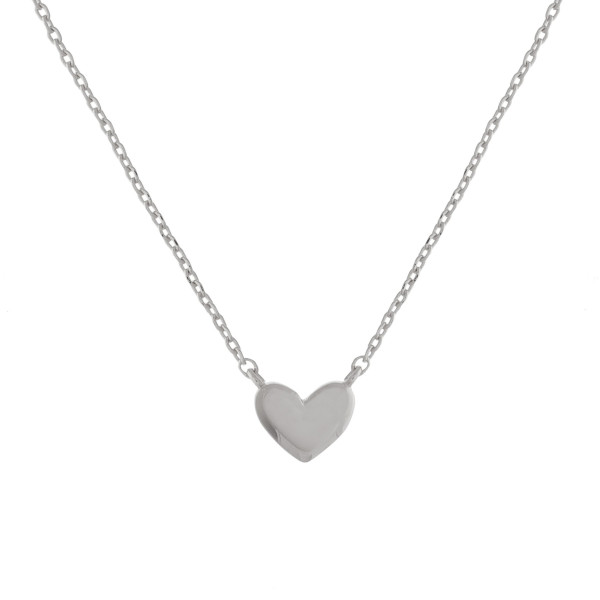 """Long metal necklace with heart pendant. Approximate 17.5"""" in length."""