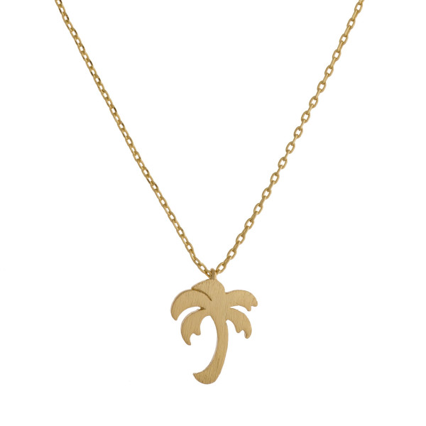 """Long metal dainty necklace with tropical tree pendant. Approximate 17"""" in length."""