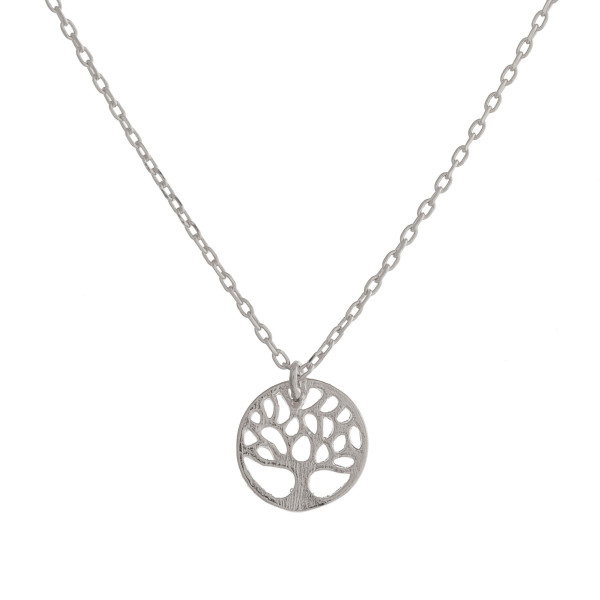 """Long metal dainty necklace with tree of life pendant. Approximate 17"""" in length."""