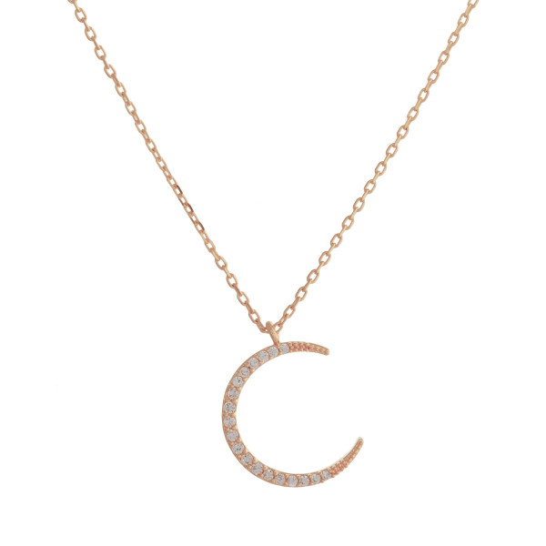 "Long metal necklace with  rhinestone crescent pendant. Approximate 17.5"" in length."