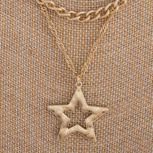 "Gold layered necklace featuring a star pendant. Measures approximately 20"" in length."
