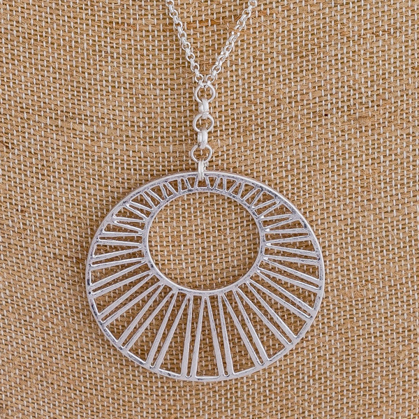 "Long chain necklace featuring a circular filigree pendant. Approximately 36"" in length."