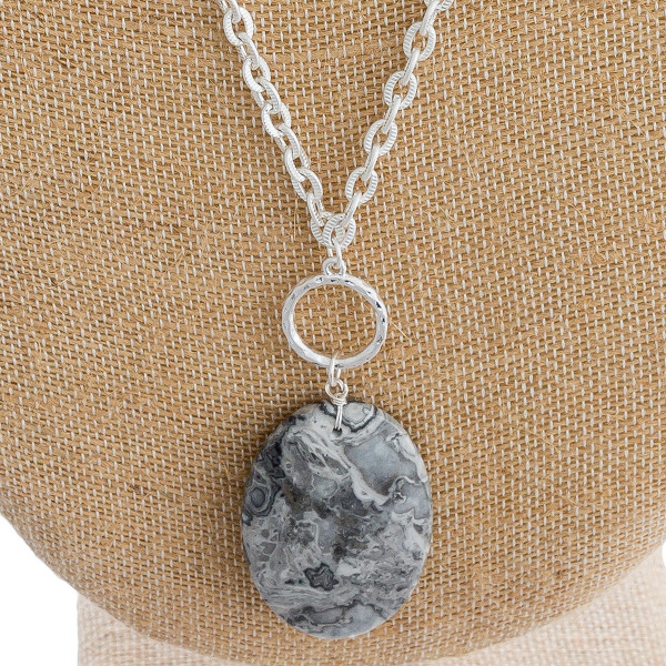 "Long silver cable chain necklace featuring a natural stone pendant. Pendant approximately 2.5"". Approximately 40"" in length overall."