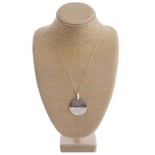 "Long chain necklace featuring a circular metal and mother of pearl pendant. Approximately 36"" in length."