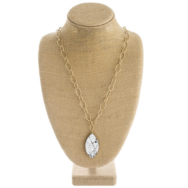 """Long oval link chain necklace featuring a wood inspired pointed oval pendant. Pendant approximately 2.5"""". Approximately 32"""" in length overall."""