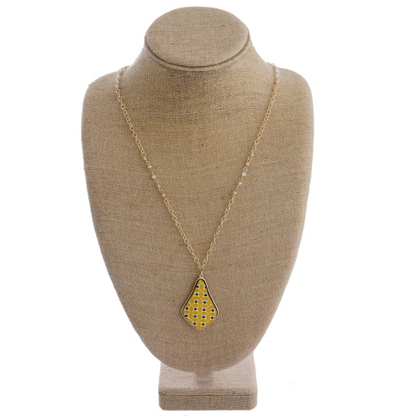 """Long gold chain necklace featuring beaded accents and a wooden pendant with a yellow patterned design. Approximately 36"""" in length."""