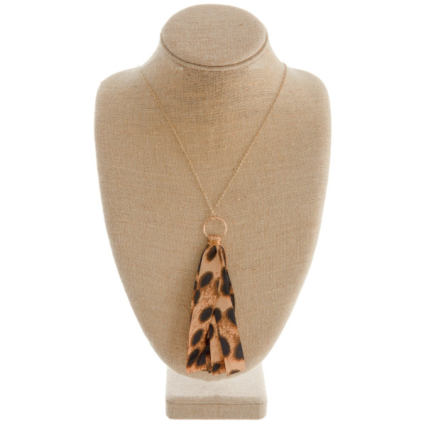 """Long gold chain necklace featuring a fabric cheetah print tassel. Approximately 36"""" in length. Tassel is approximately 6"""" in length."""
