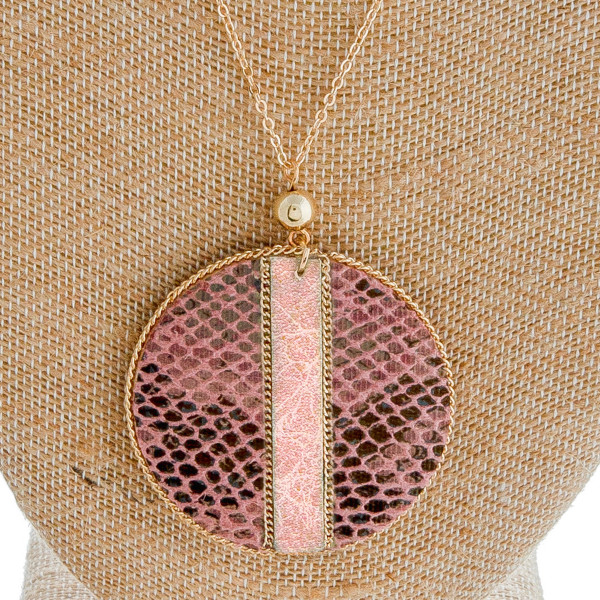 "Long dainty cable chain necklace featuring a faux leather snakeskin disc pendant with gold chain inspired accents. Pendant approximately 2"" in diameter. Approximately 34"" in length overall."