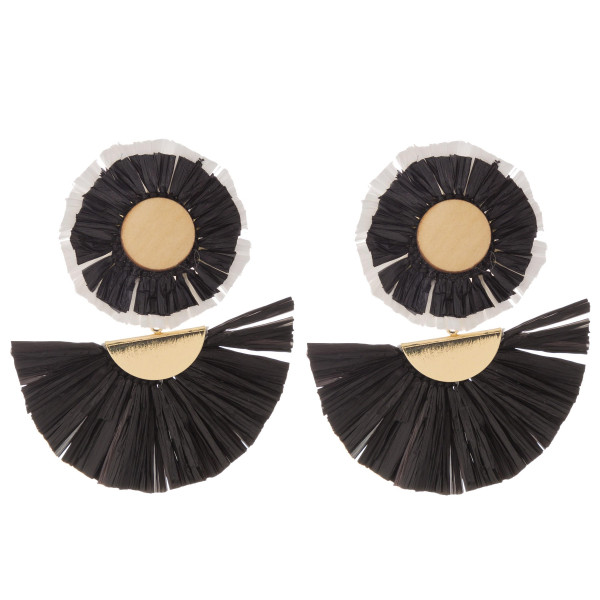 "Raffia drop earrings featuring tassel accents with a wood stud detail. Approximately 2"" in length."