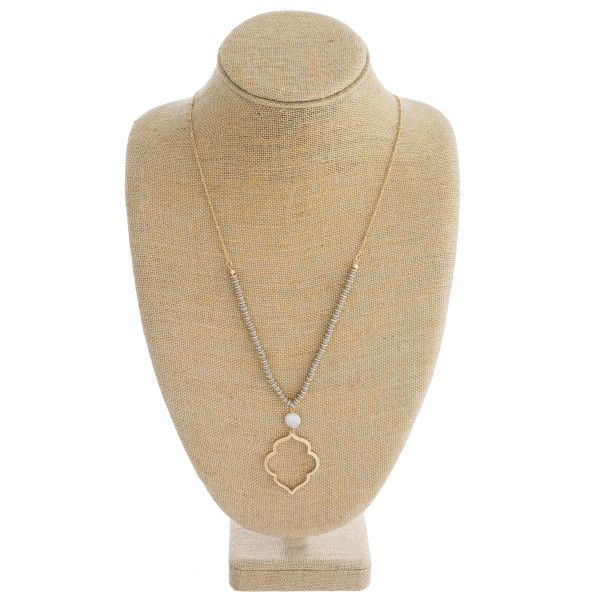 """Long satellite chain necklace featuring faceted bead details, a lotus inspired metal pendant, and a pearl accent. Pendant approximately 2"""". Approximately 34"""" in length overall."""