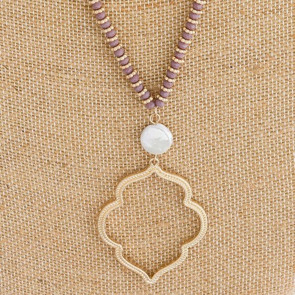 "Long satellite chain necklace featuring faceted bead details, a lotus inspired metal pendant, and a pearl accent. Pendant approximately 2"". Approximately 34"" in length overall."