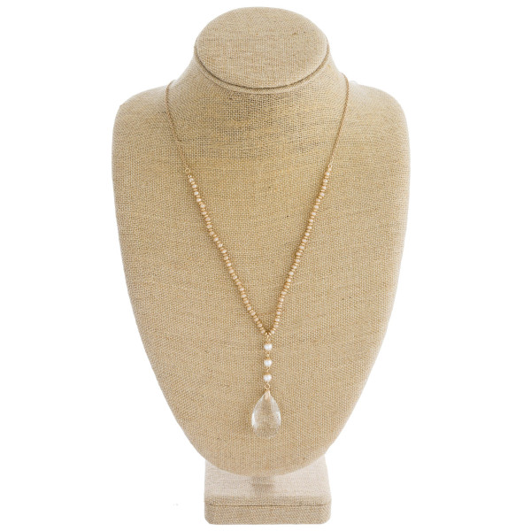 "Long cable chain necklace featuring faceted bead details, a crystal inspired teardrop pendant, and peal accents. Pendant approximately 1.5"". Approximately 34"" in length overall."