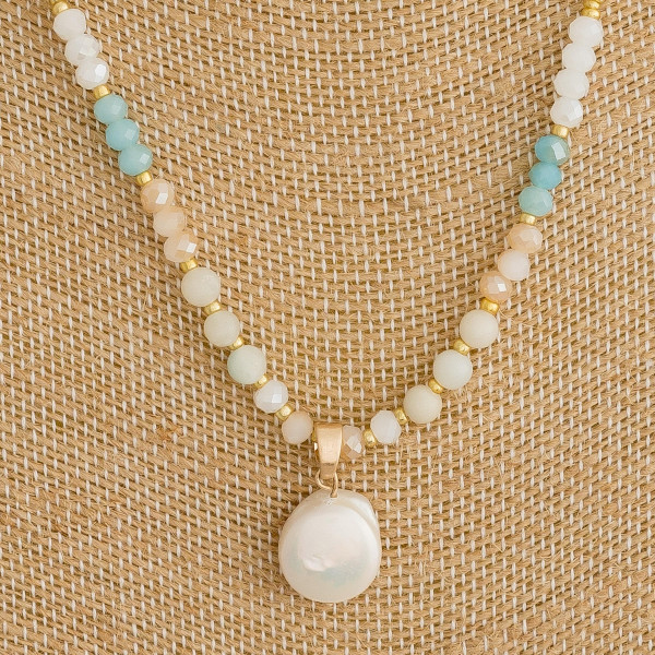 """Long beaded chain necklace featuring faceted bead details and a pearl accent. Approximately 18"""" in length."""