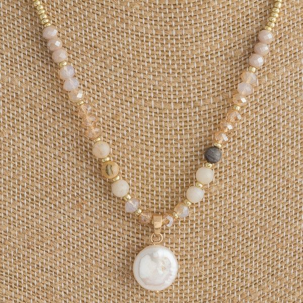 """Short beaded necklace featuring gold bead details, champagne quartz inspired accents, and a faux pearl. Approximately 16"""" in length."""