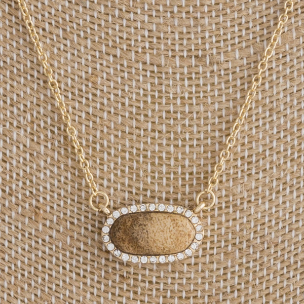 "Gold metal necklace featuring a jasper natural stone horizontal pendant with cubic zirconia details. Pendant approximately .5"". Approximately 16"" in length overall."