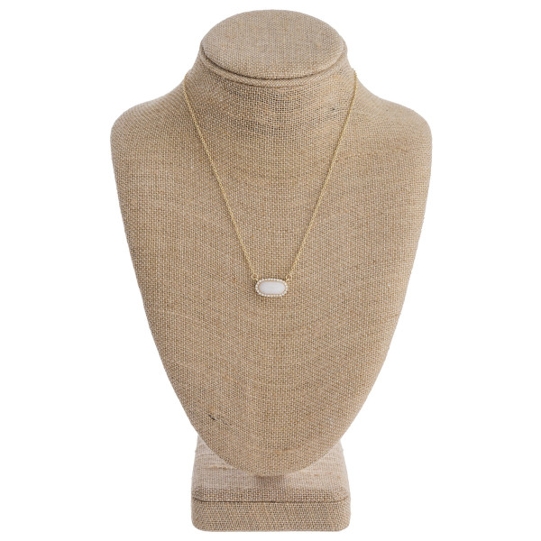 "Dainty cable chain necklace featuring a natural stone inspired bar pendant with cubic zirconia details. Pendant approximately .75"" wide. Approximately 16"" in length overall."