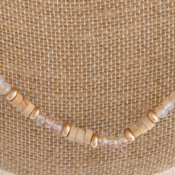 "Natural mix beaded necklace featuring wood, pearl, and glass beads. Approximately 32"" in length."