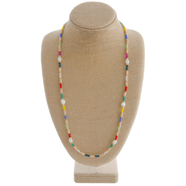 "Multicolored beaded necklace featuring wood, pearl, and glass beads. Approximately 32"" in length."